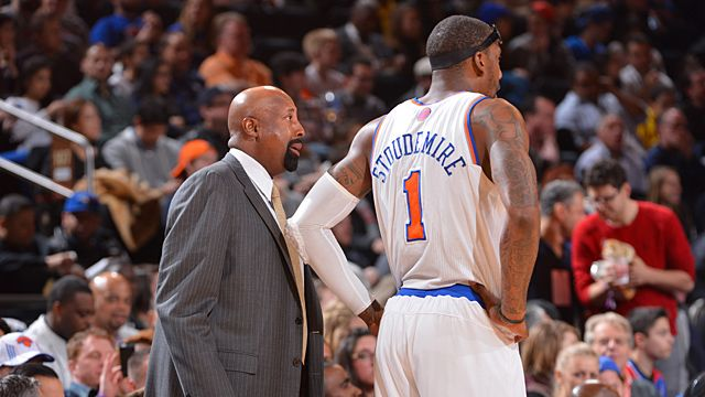 Amar'e Stoudemire #1 and Head Coach Mike Woodson of the New York Knicks