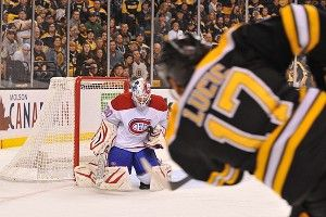 Milan Lucic #17 of the Boston Bruins shoots the puck against Peter Budaj #30 of the Montreal Canadiens