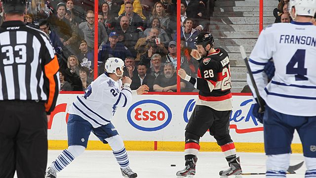 Matt Kassian #28 of the Ottawa Senators and Colton Orr #28 of the Toronto Maple Leafs