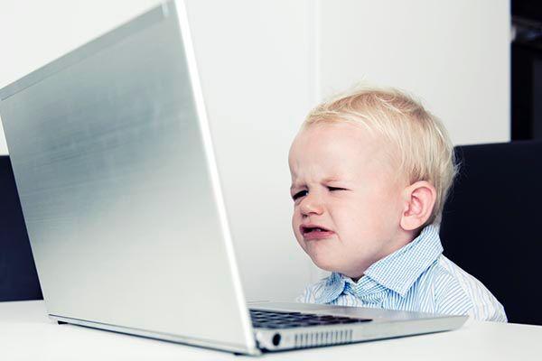 Crying Baby at Computer