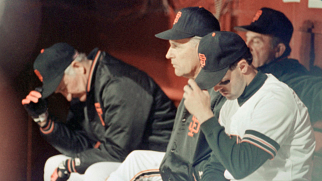 San Francisco Giants manager Roger Craig, (left), and first baseman Will Clark, (right), hang their heads