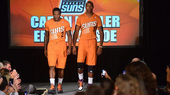 Eric Bledsoe #2 and Caron Butler #3 of the Phoenix Suns unveils new uniforms on August 15, 2013 at Scottsdale Fashion Square in Scottsdale, Arizona.