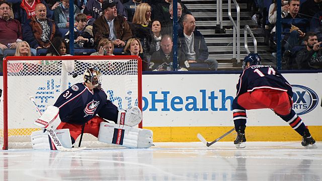 Goaltender Curtis McElhinney #31 of the Columbus Blue Jackets looks back as the puck goes into the net after it tipped off the stick of Blake Comeau #14 of the Columbus Blue Jackets