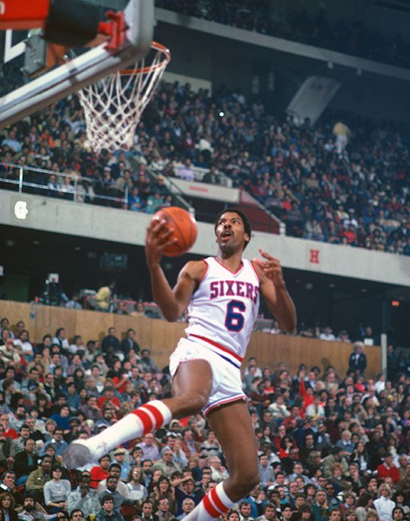 Julius Erving #6 of the Philadelphia 76ers lays the ball up during an NBA basketball game circa 1980 at The Spectrum in Philadelphia, Pennsylvania. Erving played for the 76ers from 1976 - 87.