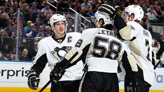 Sidney Crosby #87, Kris Letang #58, and Paul Martin #7 of the Pittsburgh Penguins