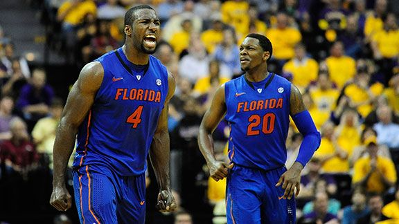 Patric Young #4 and Michael Frazier II of the Florida Gators react to a score against the LSU Tigers during a game at the Pete Maravich Assembly Center on January 12, 2013 in Baton Rouge, Louisiana.