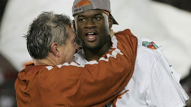 Head coach Mack Brown of the Texas Longhorns celebrates with Vince Young after defeating the USC Trojans 41-38 to win the BCS National Championship Rose Bowl Game on January 4, 2006 in Pasadena, California.