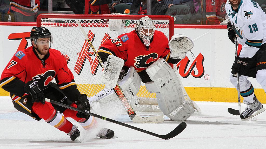 T.J. Brodie #7 and Karri Ramo #31 of the Calgary Flames