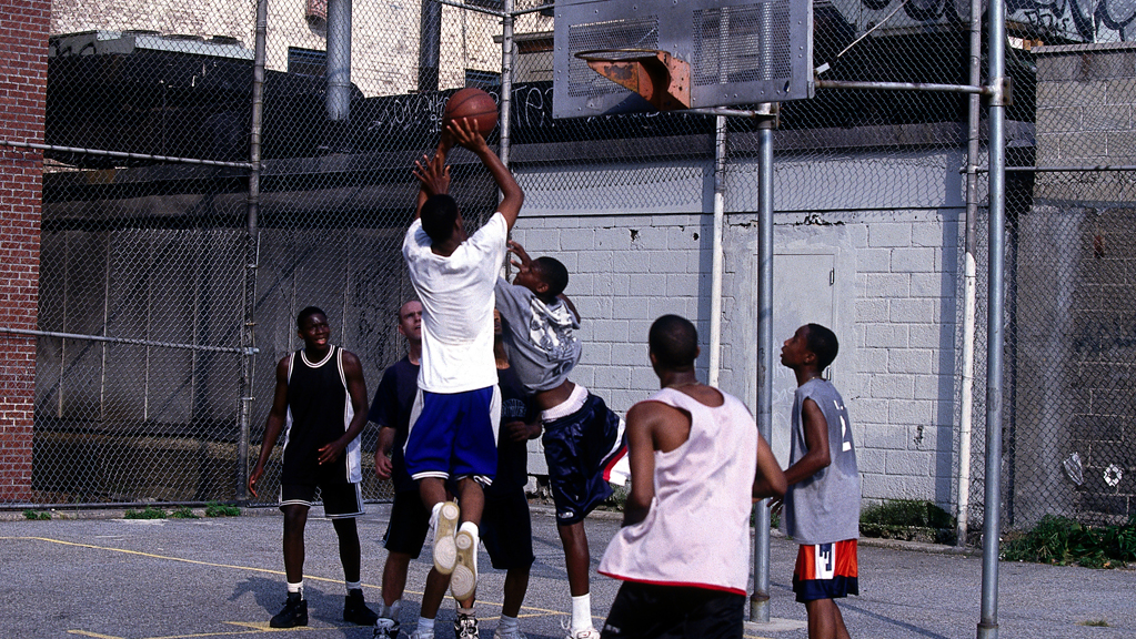 A street ball player takes a jumper