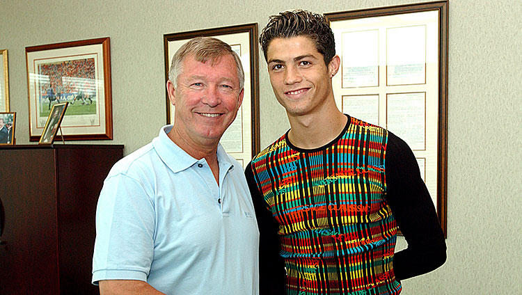 MANCHESTER, ENGLAND - AUGUST 12: Sir Alex Ferguson greets Cristiano Ronaldo as the young Portugese player signs for Manchester united at the Carrington Training Ground, Carrington on August 12, 2003 in Manchester, England.