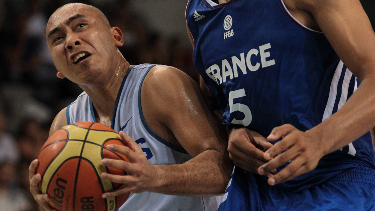 Paul Lee drives against France.