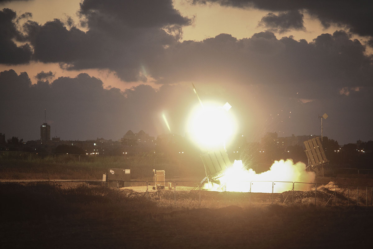 The Iron Dome air-defense system fires to intercept a rocket over the city of Ashdod on July 16, 2014.