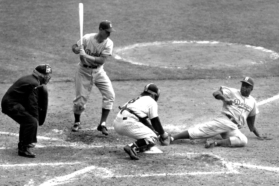 Jackie Robinson, Brooklyn Dodgers tries to steal home during