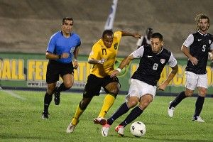 Rudolph Austin of Jamaica and Clint Dempsey of United States