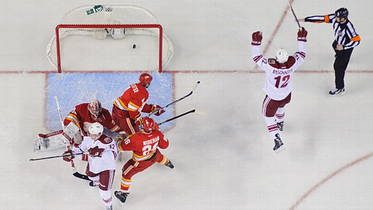Paul Bissonnette #12 of the Phoenix Coyotes celebrates after Nick Johnson #32 scores against Joey MacDonald #35