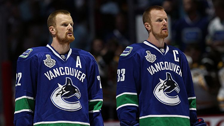 Daniel Sedin #22 and Henrik Sedin #33 of the Vancouver Canucks