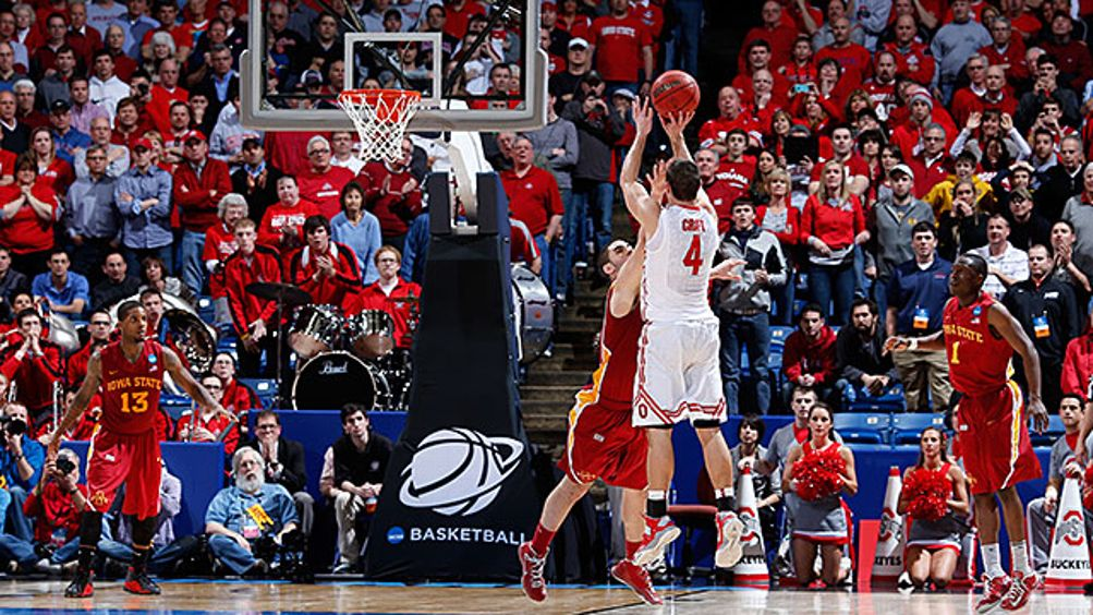 Aaron Craft #4 of the Ohio State Buckeyes shoots a game-winning three point basket against Georges Niang #31 of the Iowa State Cyclones late in the second half during the third round of the 2013 NCAA Men's Basketball Tournament at UD Arena on March 24, 20
