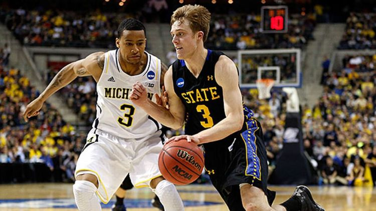 Nate Wolters #3 of the South Dakota State Jackrabbits drives in the second half against Trey Burke #3 of the Michigan Wolverines during the second round of the 2013 NCAA Men's Basketball Tournament at at The Palace of Auburn Hills on March 21, 2013 in Aub