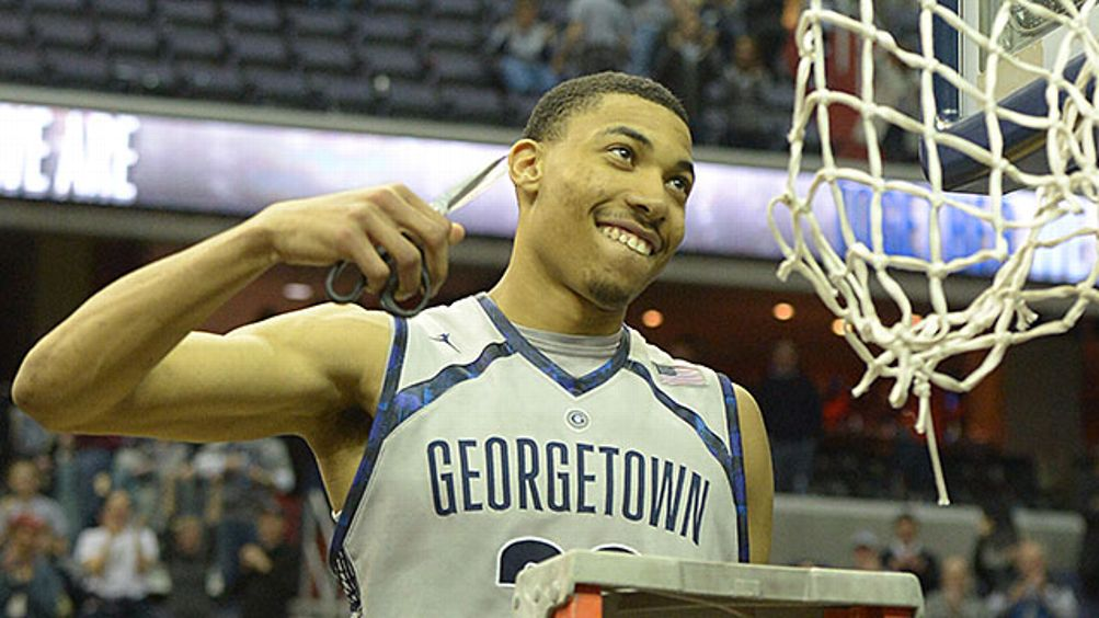Georgetown forward Otto Porter Jr. (22) is all smiles as he goes in to cut the net after their 61-39 win over Syracuse to capture the Big East regular season title on March 9, 2013 in Washington, DC