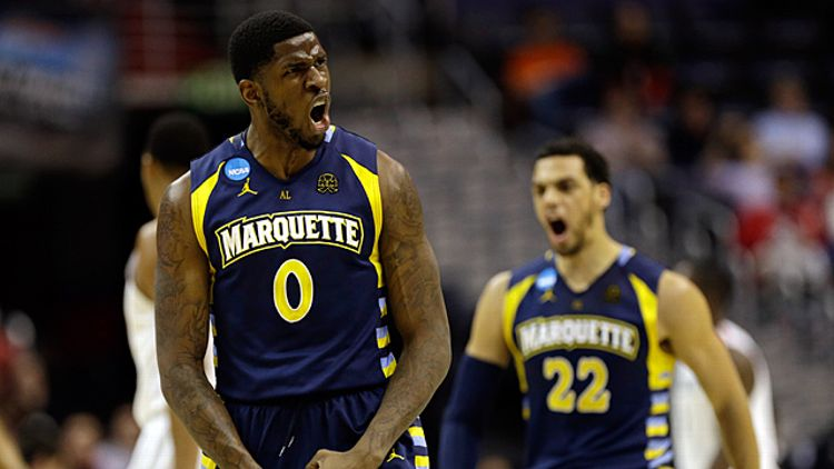 Jamil Wilson #0 and Trent Lockett #22 of the Marquette Golden Eagles