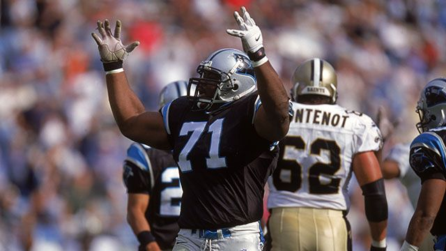 Al Lucas #71 of the Carolina Panthers celebrates on the field during the game against the New Orleans Saints at Ericsson Stadium on November 12, 2000 in Charlotte, North Carolina. The Panthers won 20-10.
