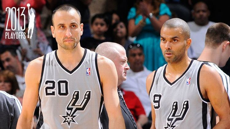 Manu Ginobili #20 of the San Antonio Spurs and Tony Parker #9 of the San Antonio Spurs look on during the Game One of the Western Conference Quarterfinals between the Los Angeles Lakers and the San Antonio Spurs on April 21, 2013 at the AT&T Center in San