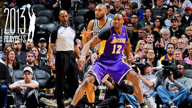 Dwight Howard #12 of the Los Angeles Lakers fights for position against Tim Duncan #21 of the San Antonio Spurs in Game Two of the Western Conference Quarterfinals during the 2013 NBA Playoffs on April 24, 2013 at the AT&T Center in San Antonio, Texas w/