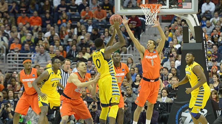 Marquette forward Jamil Wilson (0) tries to pass to the inside over Syracuse guard Michael Carter-Williams