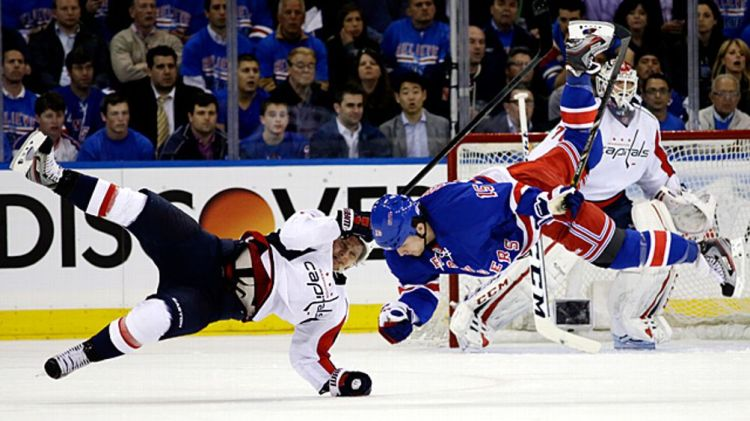 Washington Capitals left wing Martin Erat, of the Czech Republic, and New York Rangers right wing Derek Dorsett