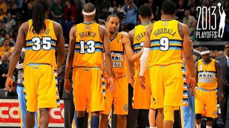 Andre Miller #24 of the Denver Nuggets welcomes his teammates Kenneth Faried #35, Corey Brewer #13, Wilson Chandler #21 and Andre Iguodala #9 of the Denver Nuggets off the court against the Oklahoma City Thunder at the Pepsi Center on January 20, 2013 in
