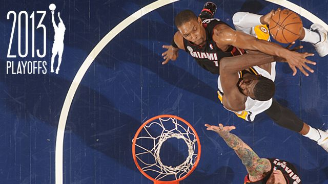 Roy Hibbert #55 of the Indiana Pacers goes to the basket as Chris Bosh #1 of the Miami Heat