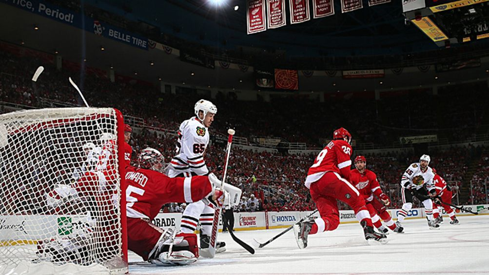 Jimmy Howard #30 and Carlo Colaiacovo #28 of the Detroit Red Wings