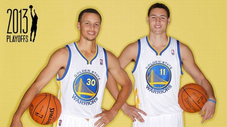 Stephen Curry #30 and Klay Thompson #11 of the Golden State Warriors poses for a portrait during 2012 NBA Media Day on October 1, 2012 in Oakland, California. w/ Grantland NBA Playoffs Logo