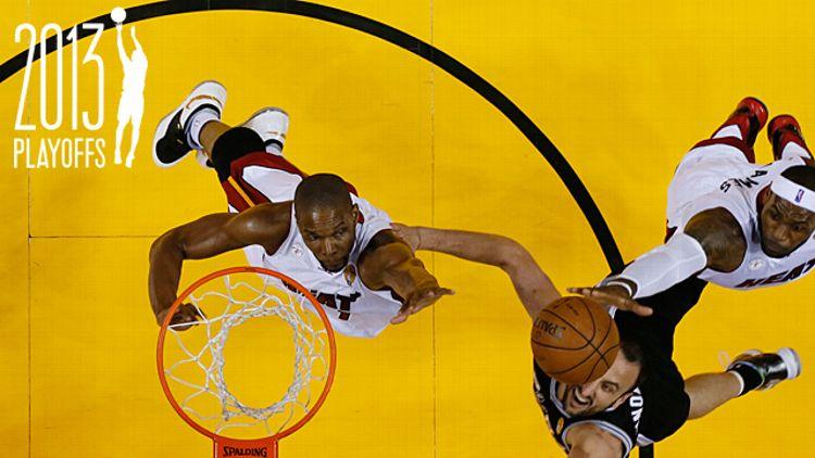 Miami Heat center Chris Bosh (1), left, and forward LeBron James (6) block a shot to the basket by San Antonio Spurs guard Manu Ginobili