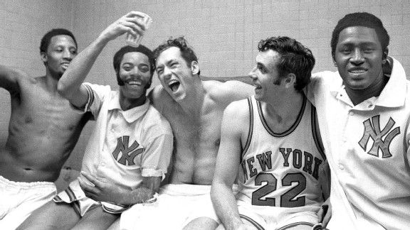 The New York Knicks' starting five -- Dick Barnett, Walt Frasier, Bill Bradley, Dave DeBusschere, and Willis Reed (l. to r.) -- rejoice in the dressing room after winning their fifth playoff game against the Milwaukee Bucks, by a lopsided score of 132-96,