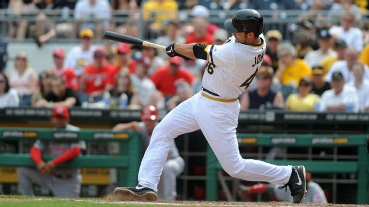 Garrett Jones #46 of the Pittsburgh Pirates becomes the first Pirates player to hit a home run directly into the Allegheny River during the eighth inning against the Cincinnati Reds at PNC Park on June 2, 2013 in Pittsburgh, Pennsylvania.