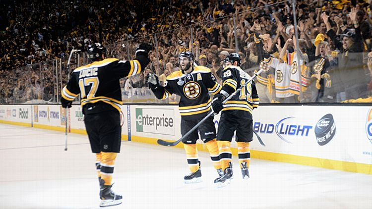 Milan Lucic #17, Patrice Bergeron #37 and Tyler Seguin #19 of the Boston Bruins