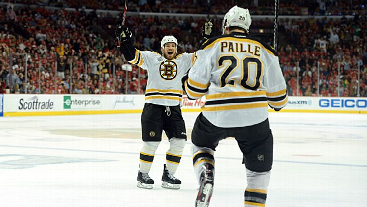 Daniel Paille #20 and Andrew Ference #21 of the Boston Bruins