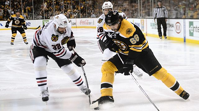 Jaromir Jagr #68 of the Boston Bruins tries to pass Michal Rozsival