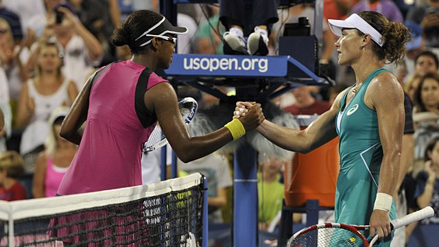 Victoria Duval (L) of the US greets Samantha Stosur (R) of Australia