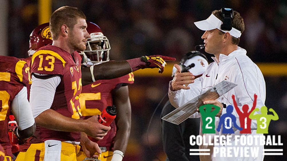 Head Coach Lane Kiffin and Max Wittek #13 of the USC Trojans talk on the sideline during a 22-13 loss against the Notre Dame Fighting Irish at Los Angeles Memorial Coliseum on November 24, 2012 in Los Angeles, California.