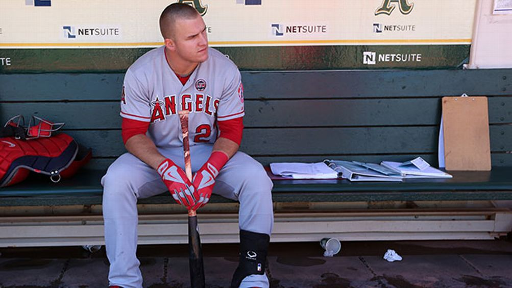 Mike Trout #27 of the Los Angeles Angels gets ready in the dugout before the game against the Oakland Athletics at O.co Coliseum on Wednesday, September 18, 2013 in Oakland, California.