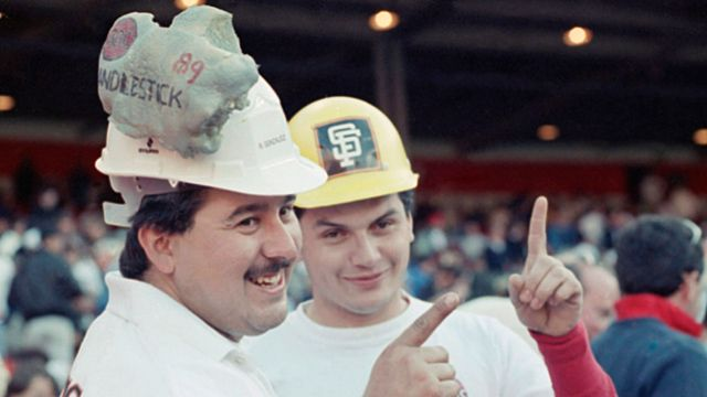 Rene Gonzalez (left) of Fresno, Calif, has a chunk of concrete from Candlestick Park