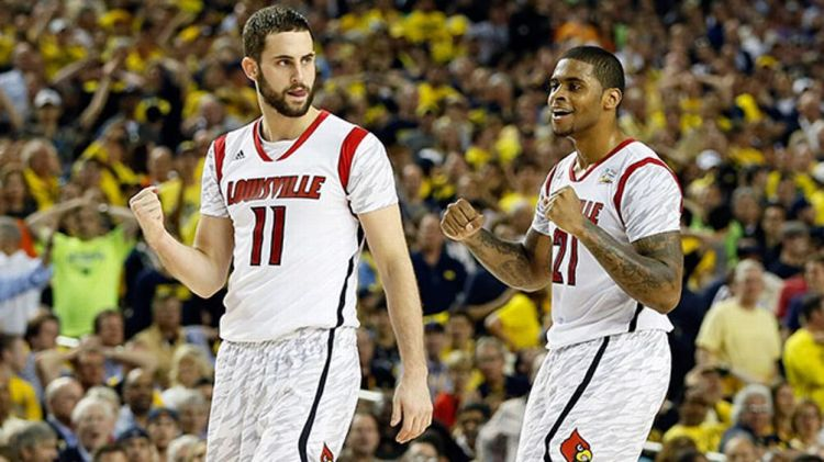 Luke Hancock #11 and Chane Behanan #21 of the Louisville Cardinals celebrate after they won 72-68 against the Wichita State Shockers during the 2013 NCAA Men's Final Four Semifinal at the Georgia Dome on April 6, 2013 in Atlanta, Georgia.