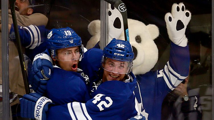 Tyler Bozak #42 and Joffrey Lupul #19 of the Toronto Maple Leafs