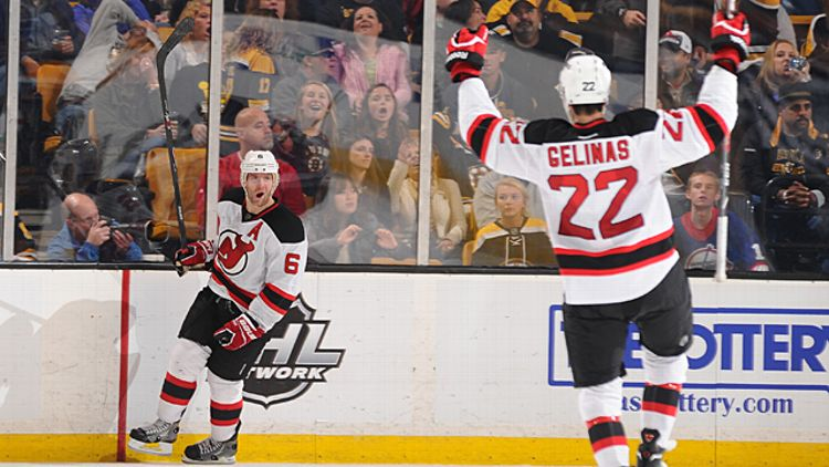 Andy Greene #6 and Eric Gelinas #22 of the New Jersey Devils