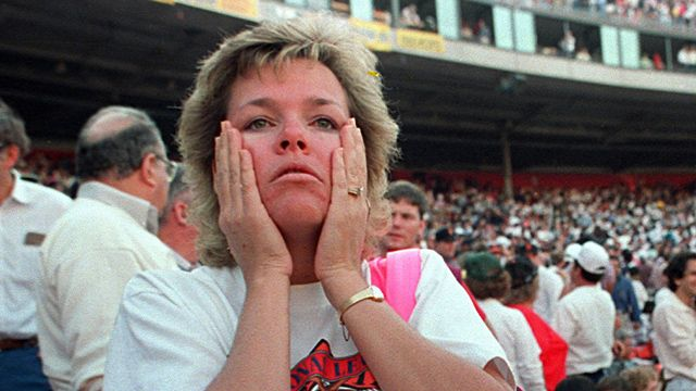 A fan reacts to the shaking at the park in October 1989 just after the Loma Prieta earthquake.