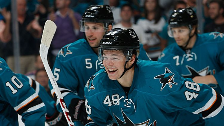 Tomas Hertl #48, Jason Demers #5 and Brad Stuart #7 of the San Jose Sharks
