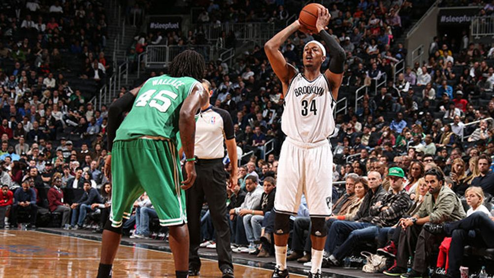 Paul Pierce #34 of the Brooklyn Nets passes the ball against the Boston Celtics during a preseason game at the Barclays Center on October 15, 2013 in the Brooklyn borough of New York City.