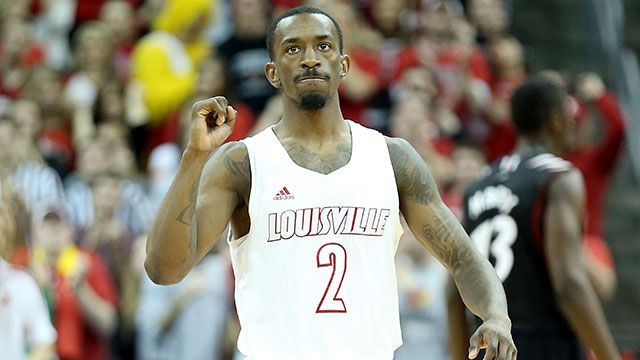 Russ Smith #2 of the Louisville Cardinals celebrates during the game against the Cincinnati Bearcats at KFC YUM! Center on March 4, 2013 in Louisville, Kentucky.